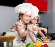 Two little girl cook Royalty Free Stock Photography