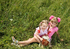 Two little girl in green grass. Stock Photos