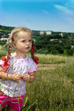 Two little girl in green grass. Stock Photography