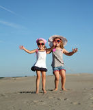Two little girl jumping Royalty Free Stock Photography