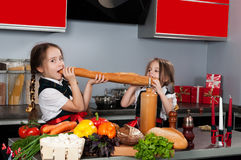 Two little girl in the kitchen Royalty Free Stock Images