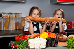 Two little girl in the kitchen Royalty Free Stock Photo