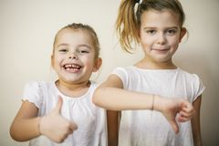 Thumb up and down. stock images