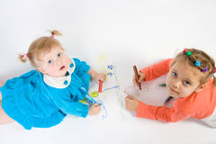 Two little girl painting Stock Image