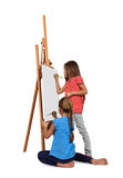 Two little girl painting Stock Photos