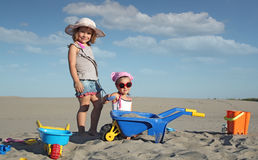 Two little girl play in sand Royalty Free Stock Photography