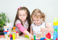 Two little girl playing Royalty Free Stock Photography
