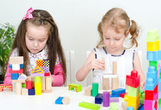 Two little girl playing Stock Images
