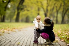 Two little girl`s sisters in autumn park stock image