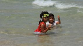 Two little girl in the sea stock footage