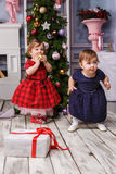 The two little girl standing at studio with christmas decorations Royalty Free Stock Images