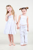 Two little girl in white clothes stand Royalty Free Stock Photography