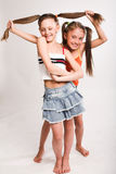 Two little girls. With long hair Stock Photos