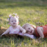 Two little girls. Playing on the grass Royalty Free Stock Photos