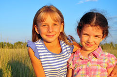 Two little girls. In the field Stock Photos