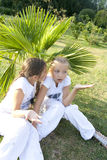 Two little girls. The little girl tells a secret to the friend Royalty Free Stock Photos