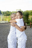Two little girls. Little girl embraces the sister in park Royalty Free Stock Image