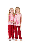 Two little girls. In red  isolated on white Stock Images