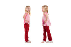 Two little girls. In red  isolated on white Royalty Free Stock Photo