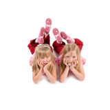 Two little girls. In red lying isolated on white Stock Image