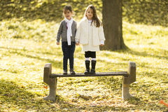 Two little girls at the autumn park. Little girls in the park in autumn Stock Photos