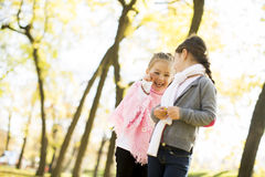 Two little girls at the autumn park. Little girls at the autumn park Stock Photo