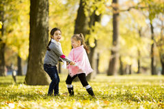 Two little girls at the autumn park Royalty Free Stock Images