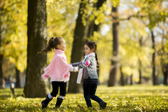 Two little girls at the autumn park Stock Image