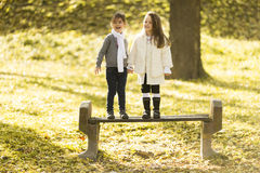 Two little girls at the autumn park. Little girls at the autumn park Royalty Free Stock Photos
