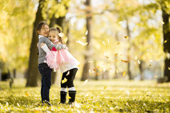 Two little girls at the autumn park. Little girls at the autumn park Stock Image