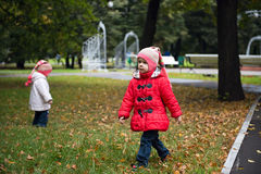 Two little girls in autumn park Royalty Free Stock Images