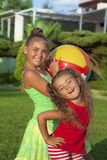 Two little girls with a ball Stock Image