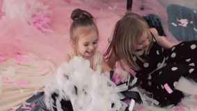 Two little girls with balloons on holiday. Jump and laugh stock video footage