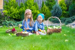 Two little girls with baskets full of harvest of Stock Images