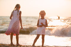 Two little girls on the beach Royalty Free Stock Image