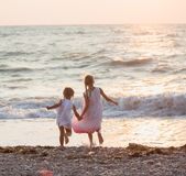 Two little girls on the beach Stock Photo