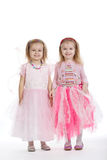 Two little girls - best friends on white. Background Royalty Free Stock Photos