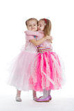 Two little girls - best friends on white. Background Royalty Free Stock Image