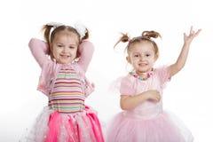 Two little girls - best friends on white Stock Photo