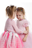 Two little girls - best friends on white Stock Photos