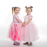 Two little girls - best friends on white. Background Stock Photos