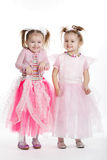 Two little girls - best friends on white Stock Image