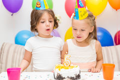 Two little girls at a birthday party Royalty Free Stock Photos