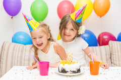 Two little girls at a birthday party Royalty Free Stock Photography