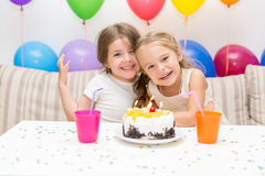Two little girls at a birthday party Royalty Free Stock Images