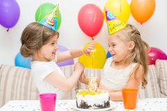 Two little girls at a birthday party Stock Image