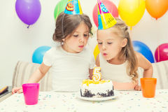 Two little girls at birthday party Royalty Free Stock Photography