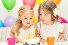 Two little girls at birthday party Royalty Free Stock Photos