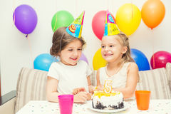Two little girls at birthday party Stock Photos