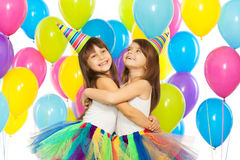 Two little girls at birthday party Stock Image